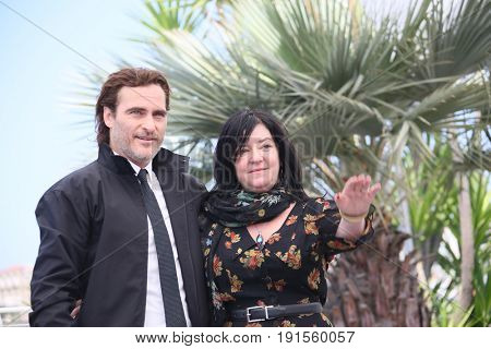Joaquin Phoenix,  Lynne Ramsay attend the 'You Were Never Really Here' photocall during the 70th  Cannes Film Festival at Palais des Festivals on May 27, 2017 in Cannes, France.