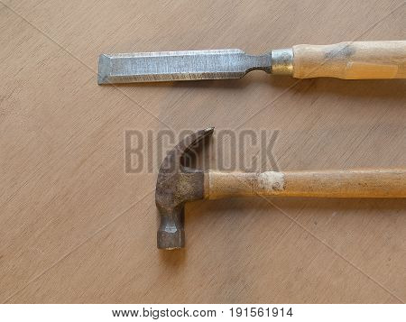 Carpenter's tools, Hammer and chisel on wooden table bottom