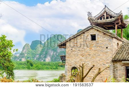 View on Traditional chines house in karst landscape by Yangshuo - China