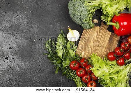 Assortment Of Fresh Vegetables (pepper, Cherry Tomatoes, Onions, Garlic, Broccoli, Lettuce) On A Dar