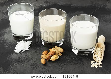 Vegan Oat, Almond, Coconut Milk In Glass On A Dark Background. Non-dairy Milk