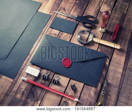 Vintage blank black stationery set on wooden table background. ID template. Mockup for branding identity for designers.