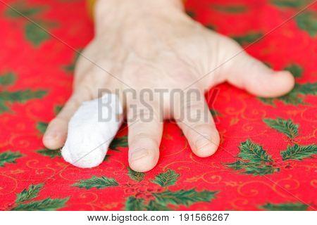 Close up photo of bandaged ring finger