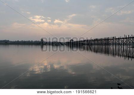U-BEIN BRIDGE/AMARAPURA, MYANMAR JAN 22: U-Bein bridge at dusk January 22, 2016, U-Bein bridge/Amarapura.