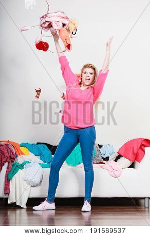 Happy Woman Throwing Clothes Above Head