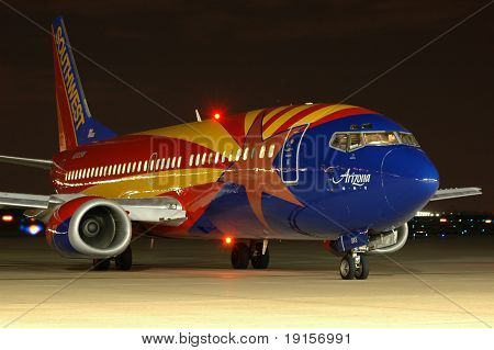 Southwest Airlines plane with Arizona flag taxiing at night