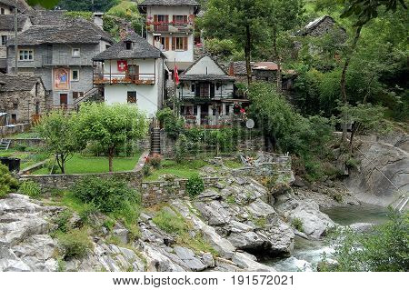 Stone houses and green gardens of Lavertezzo next to the Verzasca river - Switzerland