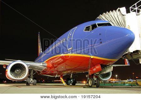 Southwest airlines airplane at the gate at night