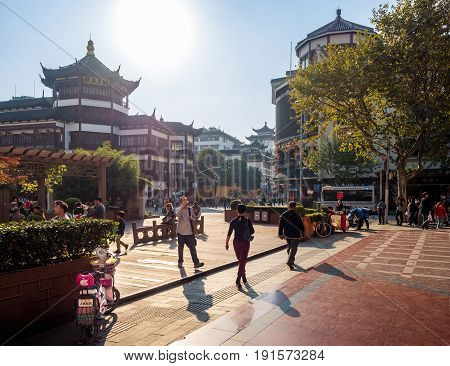 Shanghai, China - Nov 4, 2016: Around Yu Yuan (Yu Garden) - Afternoon street scene near shops and public park. People out and about. Street photography.