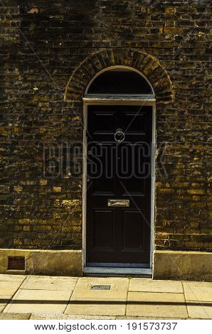 Stylish Entrance To A Residential Building, An Interesting Facade Of The Old Brick Arches Above The