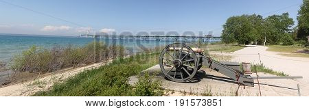 A cannon sits on a beach on the shores of Straits of Mackinac, Michigan