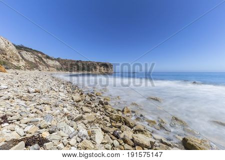 Rocky coast with blurred water motion at Abalone Cove Shoreline Park in Ranch Palos Verdes, California.