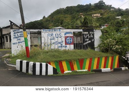 ST. GEORGE'S, GRENADA - JUNE 13, 2017: Street sign praise US and Caribbean Heroes for liberating Grenada in St. George's, Grenada