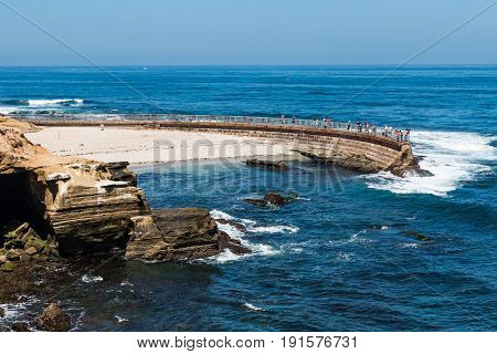 LA JOLLA, CALIFORNIA - JUNE 16, 2017:  The historic La Jolla Children's Pool with adjacent eroded cliffs in San Diego County.