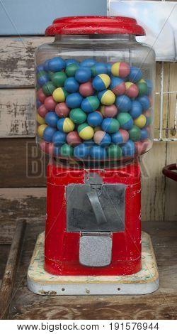 Bubble gum ball in rusty vending machine in retro style.