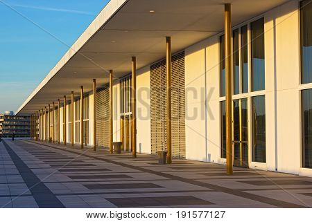 Balcony of The John F. Kennedy Center for Performing Arts at sunset before concert. Watergate complex has seen adjacent to the center building.