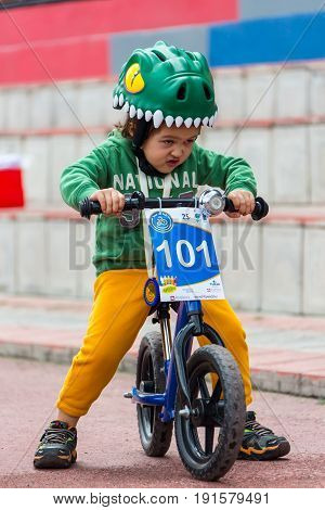 KAZAKHSTAN, ALMATY - JUNE 11, 2017: Children's cycling competitions Tour de kids. Children aged 2 to 7 years compete in the stadium and receive prizes. Little boy rides a tricycle on the road.