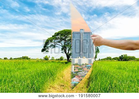 Ecology Concept Hand pull Invade the forest a building