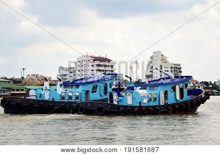 Thai People Sailing Barge And Tug Boat Cargo Ship In Choaphraya River