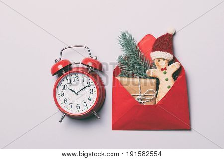 Red Alarm Clock And Christmas Gifts In Envelope