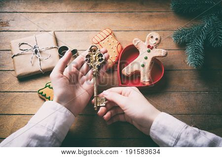 Hands Holding Cgilden Christmas Key
