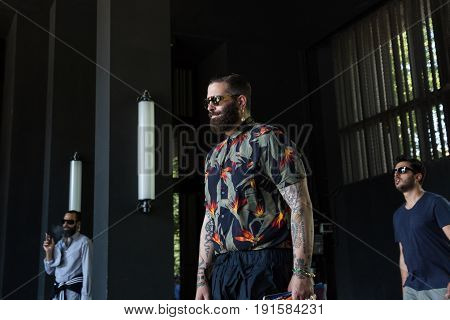 MILAN ITALY - JUNE 17: Fashionable people pose outside Neil Barrett fashion show during Milan Men's Fashion Week on JUNE 17 2017 in Milan.