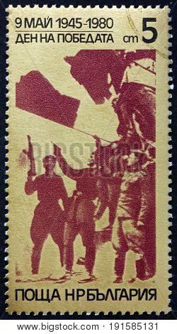 BULGARIA - CIRCA 1980: a stamp printed in Bulgaria shows Raising Red Flag Reichstag Building Berlin Armistice 35th Anniversary circa 1980