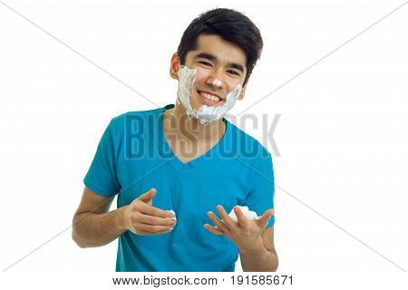 Portrait of a cheerful guy with beard foam isolated on a white background close-up