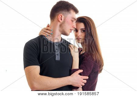 sensual beautiful couple stand in the Studio and posing for the camera isolated on white background