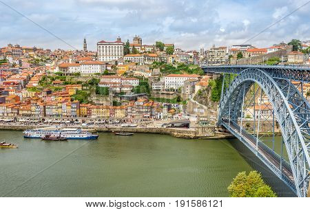 PORTO,PORTUGAL - MAY 13,2017 - Embankment Ribeira of Douro River with bridge of Luis I. in Porto. Porto is located along the Douro river estuary in Northern Portugal.