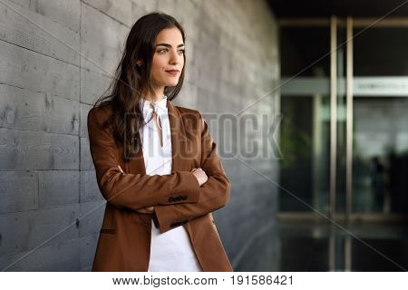 Young Businesswoman Standing Outside Of Office Building.
