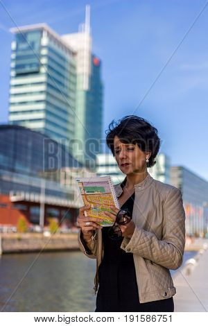 Amsterdam the Netherlands - May 31 2017: well dressed woman in city looking at map