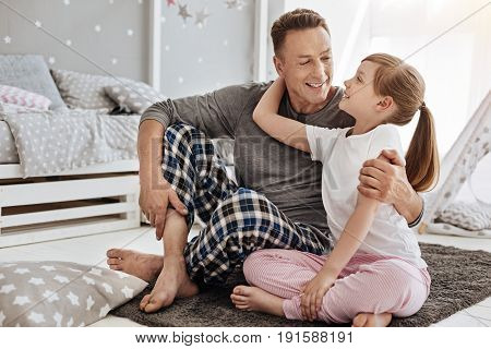 Love you, dad. Cute emotional pretty child and her father starting a weekend day together while talking about their plans and hugging