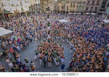 Reus, Spain - June 17, 2017: Castells Performance, a castell is a human tower built traditionally in festivals within Catalonia. and considered UNESCO Intangible Cultural Heritage of Humanity