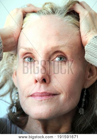 Mature female beauty fashion model expressions indoors.