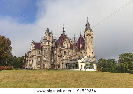 17th century Moszna Castle on a sunny day.It is a historic castle and residence located in a small village one of the best known monuments in the western part of Upper Silesia.
