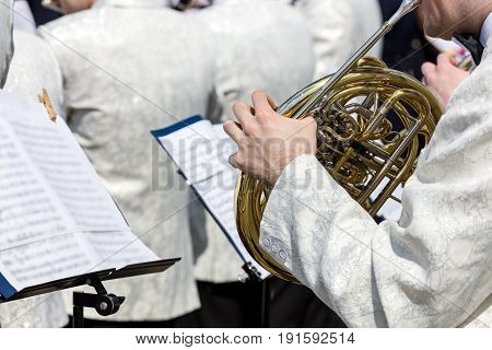 Orchestra Musician Playing French Horn During Street Fest