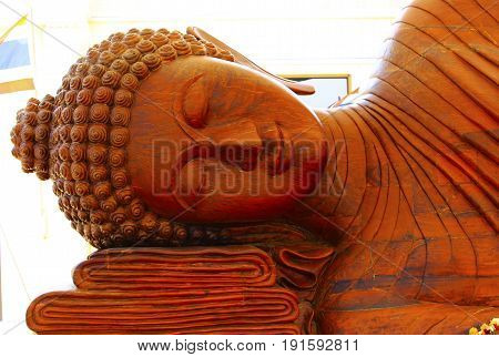 Buddha carved from wood. Hand made work of faith. The original art of Asia Thailand.