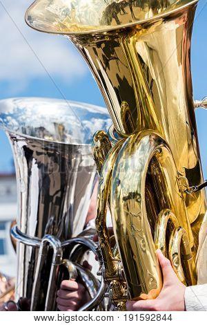 Big Brass Bass Tubas Against Blue Sky Background
