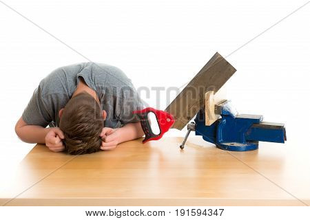 Listless Teenager In Professional Training With Saw