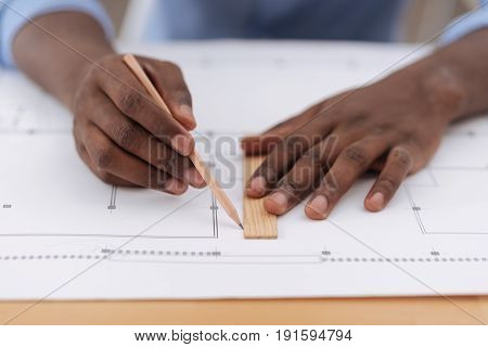 Perfect line. Close up of professional drawing tools being used by a nice skillful male engineer while doing the drawing