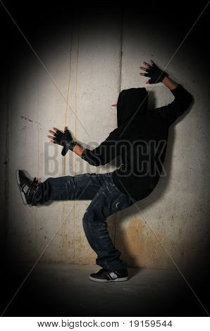 Group of Hiphop dancer posing isolated against a brunge wall