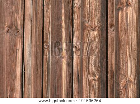 wooden background old planks with some knotholes