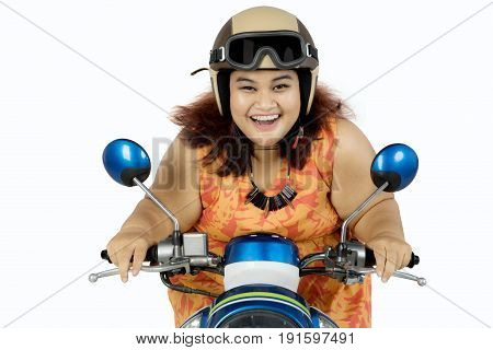 Portrait of fat woman driving a motorcycle with helmet on head isolated on white background