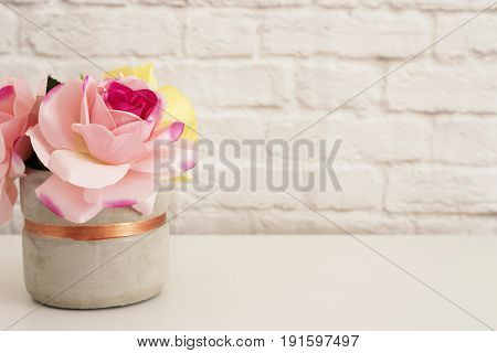 Pink Roses Mock Up. Styled Photography. Brick Wall Product Display. White Desk. Vase With Pink Roses