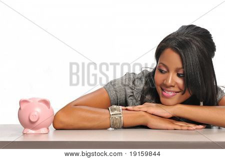 African American Woman looking at a piggy bank isolated on a white background
