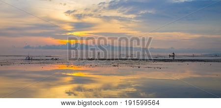 Sunrise at Pak Pra lakePattalungThailand. Silhouette of traditional fishing methodfisherman.non focus and blur.