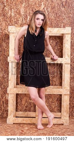Full body Beautiful woman fashion style posing on wooden wall in studio photo. Style and vogue