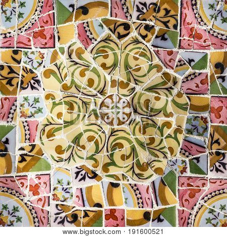 Glass mosaic ceramic tile decoration in Park Guell, Barcelona, Spain.