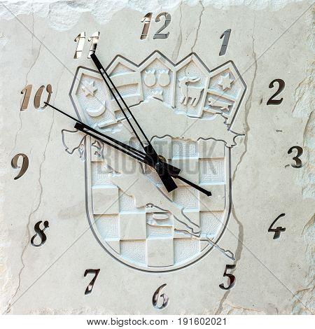 Vintage clock, white stone souvenir in Croatia